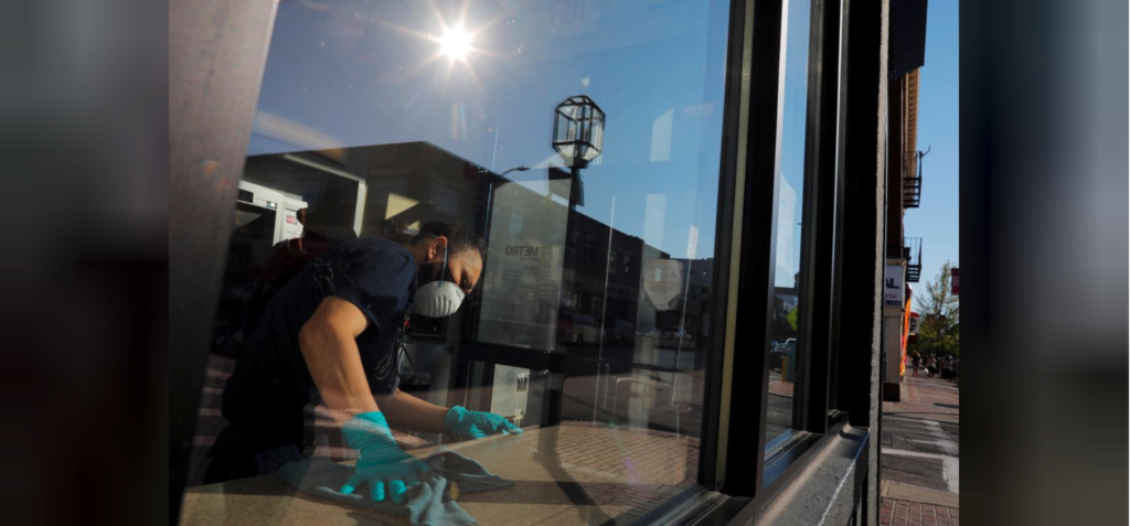 A worker cleans the surfaces in a bank amid the coronavirus disease (COVID-19) outbreak in Chelsea, Massachusetts, U.S., May 20, 2020.